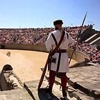 Germanic actor looking into the packed amphitheatre.
