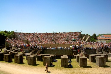 View of the pillars and packed stands of the reconstructed amphitheatre.