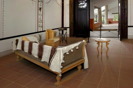 Reconstructed furniture and wall paintings in the Roman Hostel.