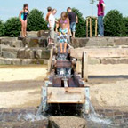 Children playing on the water playground.