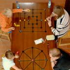 Family playing a Roman board game.