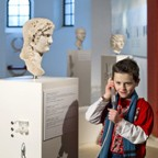 A boy listens to stories told in the exhibition.