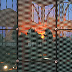 Sunset being reflected on the glass facade of the protective building.
