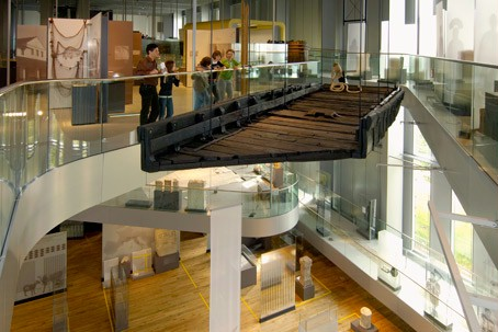 A Roman ship is suspended from the ceiling of the RömerMuseum.