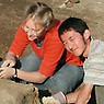 Two students working at the excavation site.