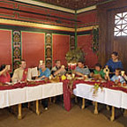 Visitors eating in the restaurant of the Roman Hostel.