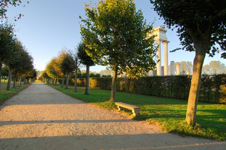View along one of the park avenues with the partially reconstructed harbour temple in the background.