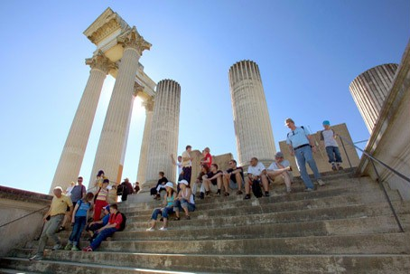 A group of visitors on the steps of the harbour temple.