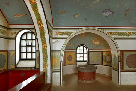 Looking into the hot bath of the Hostel's reconstructed hot springs with splendid wall paintings.