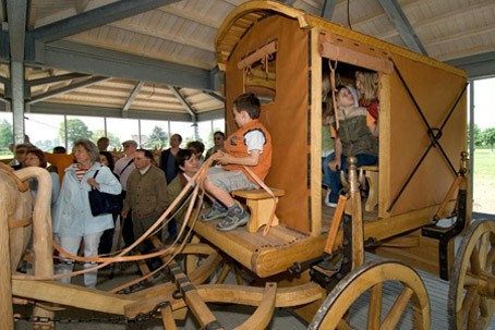 Kids exploring a reconstructed Roman carriage.