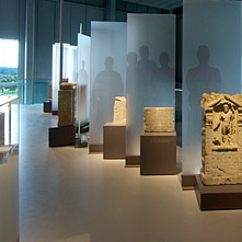 Several Roman tombstones and votive stones with inscriptions.