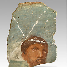 Roman mural painting with the portrait of a bearded man.